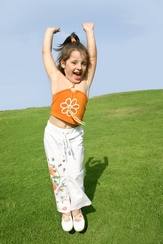 Happy Little Girl at Wee Care Preschool jumping for joy!