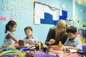 children with teachers in a preschool classroom